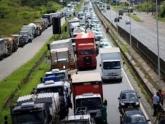 FMI vê crescimento menor no Brasil em 2018/19 por greve dos caminhoneiros e aperto global
