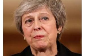 Premiê britânica luta para sobreviver a crise provocada por acordo do Brexit